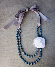 old necklace diy  wonder if you could take a necklace and fold it in half and tie ribbons to it?