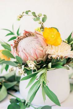 King Protea floral centerpiece  Photography, Styling & Floral Design : Leeves & Berries Read More on SMP: http://www.stylemepretty.com/living/2016/11/03/a-modern-floral-baby-shower/