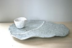 Serving platter, Whistler series, handmade gray porcelain//Custom order  I feel that Ive created the ultimate Golem Designs object, that is simultaneously rustic and elegant, simple and sophisticated.  I hand shape these platters from high fired porcelain, so although no one is the same, they all share lovely proportions and Golems meticulous glazing. Its food, microwave and dishwasher safe. Each platter comes with unique handmade snow white cup/saucer.  Cool Gray with white st...
