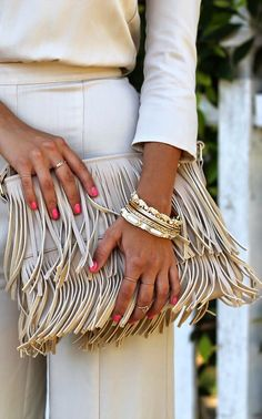 fringe bag and gold accessories