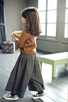 kid culottes with fun sneakers, camel sweater, and short polished hair
