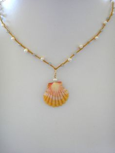 Sunrise Shell on Gold Braided Cord with Pearls and Apatite. $128.00, via Etsy.
