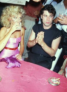 long ago...Olivia Newton John and John Travolta.  Looks like a candid behind the scenes of Grease.