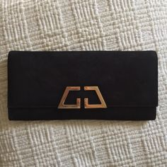 "Gucci ""G night"" clutch AUTHENTIC 'G night' evening bag with square GG detail. light gold hardware black suede snap closure inside pocket leather lining ***remember to check out my Instagram @brieharding to see my closet in motion. Everything in my closet has been curated with love and I rock it myself! Gucci Bags Clutches & Wristlets"