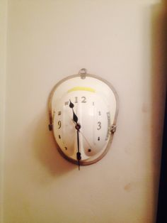 #Fire helmet turned into a wall clock. Another way of reuse and recycling old…
