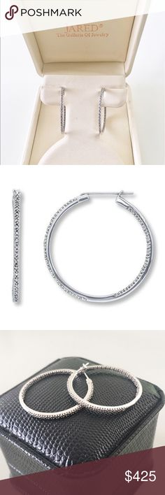 10K White Gold 1/4 ct t.w. Diamond Hoop Earrings JARED THE GALLERIA OF JEWELRY: More than 70 round diamonds are arranged inside and outside of these elegant 10K white gold hoop earrings. Total diamond weight is 1/4 carat. These fine jewelry earrings are secured with snap-lock backs. Diamond Total Carat Weight may range from .23 - .28 carats. NEVER WORN AND IN ORIGINAL BOX! Jared The Galleria of Jewelry Jewelry Earrings
