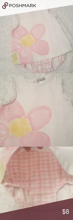 Precious little Carter's flower onesie! This sweet little outfit is made to look like two pieces in the front but it's actually a one piece as noted in the back. It is sleeveless with a little ruffle on the sleeve. Super soft and is in EUC with no signs of stains or flaws. Carter's One Pieces