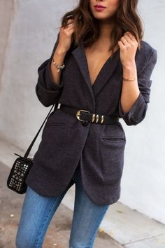 Jeans paired with belts and a jacket