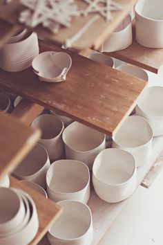 simple and light porcelain cups and altered bowls