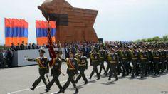 Armenian Army officer-scholars of the Vazgen Sargsyan Military Academy marching past the Sardarapat Memorial at the 2013 Armenian Republic Day Parade.