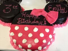 """Minnie Mouse cake I made for Emily's 3rd birthday.  Used 9"""" rounds for head and 6"""" rounds for ears.  Took 2 boxes of cake.  Used pre-made fondant by Wilton's and made frosting by scratch."""
