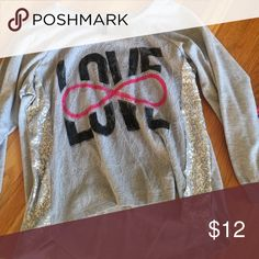 """Grey long sleeve Grey shirt with the word """"love"""" and an infinity sign on the front with sequence down the sides. NEVER WORN. VBRID apparel Shirts & Tops Tees - Long Sleeve"""