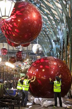 Christmas decorations going up in Covent Garden, London.  Sensational!