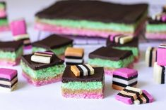 This fun, colourful slice is reminiscent of licorice allsorts, with alternating layers of biscuit and coconut, topped with decadent dark chocolate. It'll be a hit at your next fete or cake stall, and is an easy enough recipe to let the kids join in. Chocolate Slice, Chocolate Treats, Melting Chocolate, Muesli Slice, Oat Slice, Coconut Slice, Nutella Bar, No Bake Slices, Kuchen