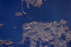 An overhead view of San Francisco, California, with Golden Gate Bridge visible at lower left.