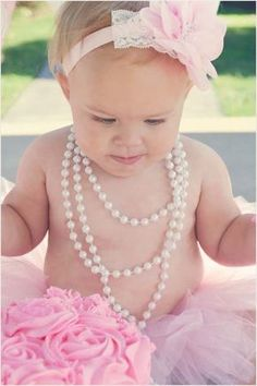 Baby Nahla's one-year photos. I want to do this in a brown tutu and headband for Lily's 1 year photos!