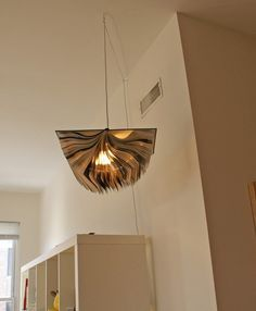 pendant light made from an old book