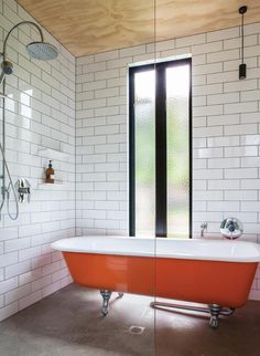 orangy bathtub ! - A simple modern family home with mid century riffs. Mono-pitch roof, walls of glass, colour blo...
