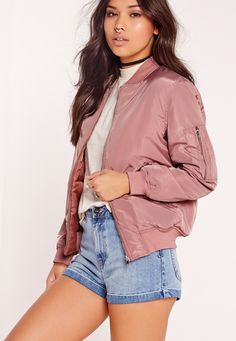 Who said bombers are sporty and boyish? Up your day-time game in this seriously babin' bomber. Featuring a mauve, dusky pink hue, two pockets to the front and ribbed collar deets, this will make sure all eyes are on you. Team with a basic t...