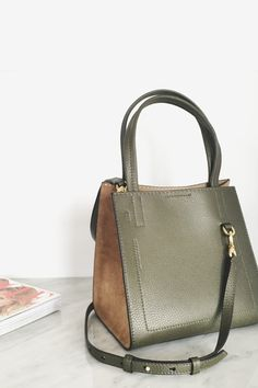 Luxe pebbled Italian leather and suede come together in our structured mini tote. With handles and a crossbody strap option, this tote is both versatile and trendy   Banana Republic
