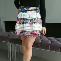 """Gorgeous floral print skirt *MORE SIZES* NWT BRAND NEW WITH TAG  Gorgeous floral print with white stripes skirt. Rows of floral elastic, white elastic and clear fabric make this skirt a true statement maker.  White lining Size small Total length approximately 15.5"""" zip up in back  Material 80% polyester 20% elastic (skirt is semi stretchy) Size small  *Juniors/ petite fit in my opinion*  *AVAILABLE IN SMALL or LARGE*   Skirts"""