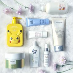 """B O D Y  L O T I O N S / M O I S T U R I Z E R S  Day 20 of the #ABmidyearstashchallenge by @peepingpomeranian and @mindyourbeauty has the topic """"Body Lotion/ Moisturizers"""" (I skipped day 19 because I do not have many bath products atm). I use body lotions frequently and always after taking a shower. I have dry skin so it really helps a lot :) .  Tonymoly x Pokemon Pikachu Body Lotion - unopened but I love the packaging  .  Thierry Mugler Angel Perfumed Body Lotion - since Angel is my…"""