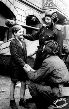 Unable to find attribution.  German boy with Russian soldiers, WW2.