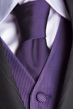 Black tux with purple pinstripe vest and solid purple tie