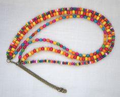 VENDU : Collier en perles de bois multicolores sur trois rangs par Boutique Astrallia : http://www.alittlemarket.com/collier/fr_reserve_collier_en_perles_de_bois_multicolores_sur_trois_rangs_par_boutique_astrallia_-10180483.html