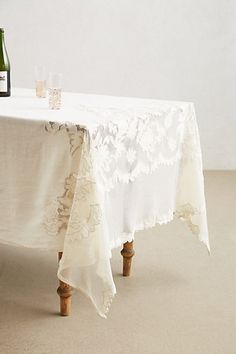 Camellia Tablecloth - anthropologie.com; soooo perfect; too expensive for me :)