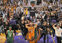Great photo. Shows the joy of the victors, the crowd, the pain of the losers, and the hustle of the professionals.