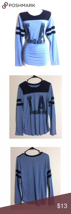 💙LA Baseball Graphic Long Sleeve Tee💙 Love this shirt super cute, stylish and trendy! NWOT! PRICE IS NOT FIRM OFFERS ACCEPTED UPON REQUEST...😊 Measurements: Armpit to Armpit: Length:  This listing is BRAND NEW WITHOUT TAGS! Material: Stranded Tops Tees - Long Sleeve