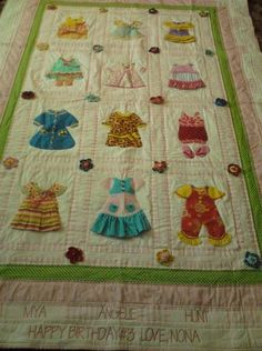 Lorraine Hunt's quilt made out of grandbabies' clothing in the blocks. LOVE this idea. Perfect to make for Charlotte as a keepsake with my baby clothes and hers. @Jeannie Perkins