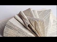 Introductory Book Sculpture Lesson - Johwey Redington Learn the basic folds in creating a book sculpture and how to modify this basic fold to create interesting designs. Old Book Crafts, Book Page Crafts, Book Page Art, Craft Books, Sculpture Lessons, Book Sculpture, Paper Sculptures, Abstract Sculpture, Folded Book Art
