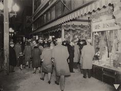 Christmas Eve, 1930. This is the sidewalk in front of the old Montgomery Ward building in the 700 block of Texas Street. Montgomery Ward became Ivan Smith Furniture and is now the home to artspace.
