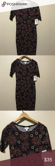 LulaRoe Julia Dress Size XXS Brand- LulaRoe   Brand new with tags women's Julia Dress Size XXS-   Adorable floral pattern- I am not a LulaRoe consultant. These are just items purchased and never worn. LuLaRoe Dresses