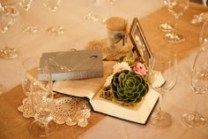 AHHHH, AHHHH! THIS!  Flowers on the books- centerpieces.