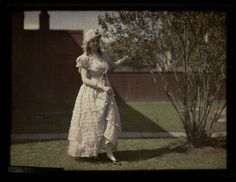Helen Messinger Murdoch | Autochrome: Helen Messinger Murdoch. Woman standing by a tree.