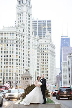 Downtown Chicago Michigan Avenue wedding picture with Wrigley Building in the background! Photo by Creative Chicago wedding photographer: Nakai Photography http://www.nakaiphotography.com