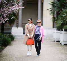 Diana and Alina from the blog Fabulous Muses enjoying Paris with their Louise Clutch and Orange Alma Epi (via www.fabulousmuses.net)