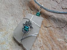 Hey, I found this really awesome Etsy listing at https://www.etsy.com/listing/177890658/wire-wrap-sea-beach-glass-necklace-hamsa