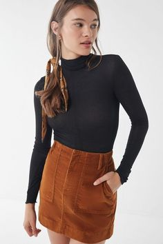 Black Turtleneck and skirt outfit. Classic lightweight knit long sleeve top, Semi sheer + ribbed with slouchy + stretchy neck from Urban Outfitters. Slim silhouette that looks great tucked in to patterned skirts or denim jeans. Simple, minimalist look. Turtleneck Outfit, Black Turtleneck, Loungewear Outfits, College Outfits, College Wardrobe, Sunday Outfits, Office Outfits, Night Outfits, Girly Outfits