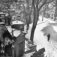 Post war winter: A lone mourner walks through The Montmartre Cemetery in the capital, Paris. For the second time in a generation, people in Europe ...