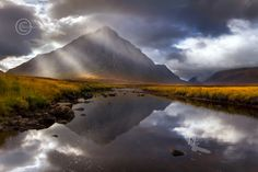 Buachaille Etive Mor , rain , and The River Coupall . Glen Coe. Western Highlands. Scotland.