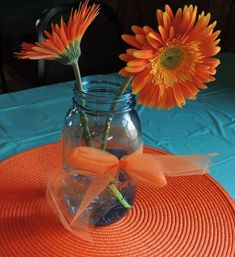 Blue Ball Mason Jars with Orange gerber daisy Gerbera Daisy Centerpiece, Orange Centerpieces, Mason Jar Centerpieces, Flower Centerpieces, Simple Centerpieces, Centerpiece Ideas, Bud Vases, Bridal Shower Tables, Bridal Shower Rustic