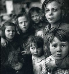 """Elliott Erwitt. Amazing how the girl in the bottom right's face can ask """"what?"""" So innocently while the girl holding her's face clearly asks """"why?""""  Excellent capturing of how our view on the world change as we grow up."""
