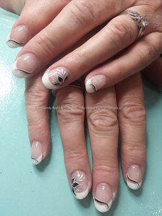 White gel french tips with freehand nail art