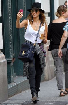 Jessica Alba cheerfully gazed into her phone as she seemingly enjoyed a FaceTime video chat with someone on the other end, in New York City.  (September 2014)