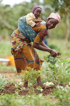 Photo of the Week: 11 September 2012 - A woman turns to smile at her laughing baby while she gardens in her village in Burkina Faso, one of the countries in the Sahel region currently suffering from a food crisis. She is a member of a collective of 54 women who each manage one hectare of land. With support from the UNICEF and other organisations the collective can now produce vegetables year-round! www.unicef.org.nz/Sound-the-Alarm*