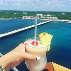 Piña Colada. Cheers to boarding day rituals and officially being on vacation, with a cherry on top.